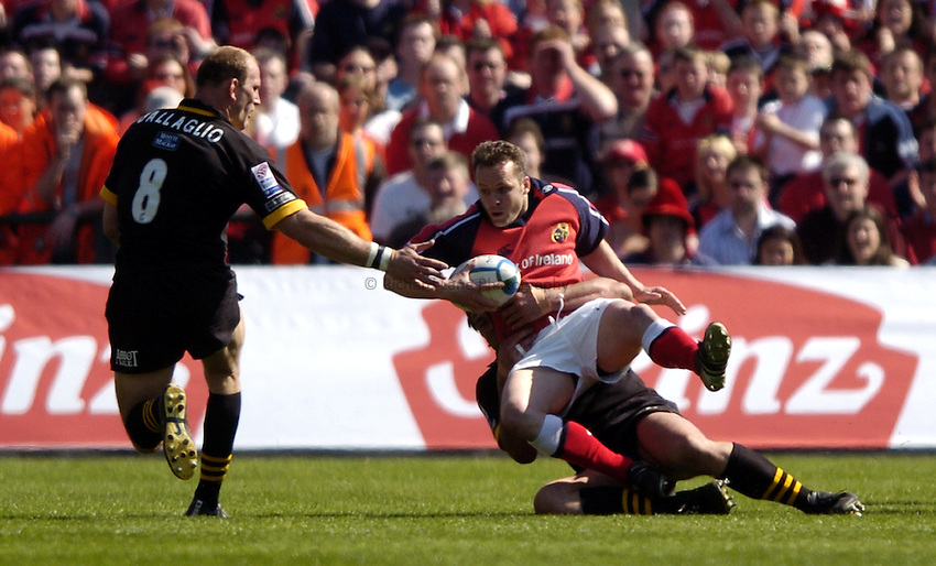 Photo. Richard Lane. .Munster v London Wasps. Heineken Cup Semi Final. 25/04/2004..Christian Cullen is stopped by Craig Dowd..