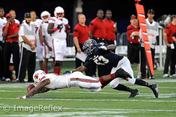 20 September 2014:  FIU linebacker Anthony Wint (53) recovers a fumble in the third quarter as the University of Louisville Cardinals defeated the FIU Golden Panthers, 34-3, at FIU Stadium in Miami, Florida.