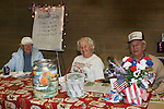 Left to right:  Joan Persinger, Betty Kieber, Norm Dills at the Quilt booth at the 2007 Fallon Senior Pro Rodeo.
