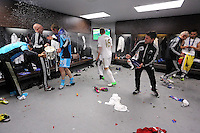Pictured: Swansea players celebrating in the changing room. Sunday 24 February 2013<br /> Re: Capital One Cup football final, Swansea v Bradford at the Wembley Stadium in London.