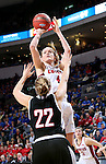 SIOUX FALLS, SD: MARCH 5: Abigail Fogg #44 from the University of South Dakota spots up for a jumper over Mikaela Shaw #22 from Nebraska Omaha during the Summit League Basketball Championship on March 5, 2017 at the Denny Sanford Premier Center in Sioux Falls, SD. (Photo by Dave Eggen/Inertia)