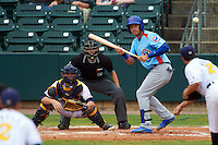 Tennessee Smokies outfielder Albert Almora (6) squares to bunt in front of catcher Justin O'Conner and umpire Alex Ransom during a game against the Montgomery Biscuits on May 25, 2015 at Riverwalk Stadium in Montgomery, Alabama.  Tennessee defeated Montgomery 6-3 as the game was called after eight innings due to rain.  (Mike Janes/Four Seam Images)
