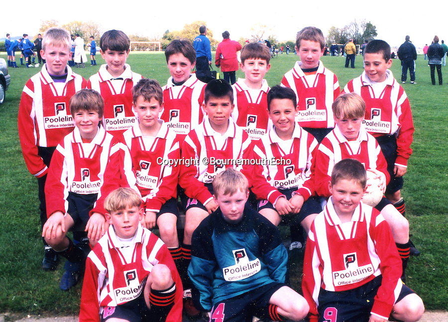 BNPS.co.uk (01202 558833)<br /> Pic: BournemouthEcho/BNPS<br /> <br /> Adam Lallana <br /> <br /> 3rd from right  back row  - as  part of the Junior Cherries  under  10's  26/4/98<br /> <br /> Background pictures: Southampton captain Adam Lallana(26) has today signed for Liverpool in a&pound;25 million pound move. His former club AFC Bournemouth are thought to rake in &pound;6million of the fee in a sell on clause.