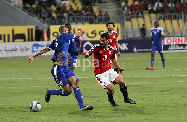 "Egypt's players compete against Chad players during their 2018 World Cup qualifying soccer match agaist Chad at Borg El Arab ""Army Stadium"" in the Mediterranean city of Alexandria, north of Cairo, Egypt, November 17, 2015. Spectators will be watching the match after receiving approval from security for the first time in a long tim. Photo by Amr Sayed"