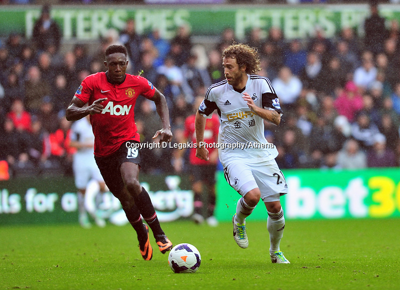 Jose Canas taking on the challenge from Manchester United's Danny Welbeck.<br /> Saturday 17 August 2013<br /> Pictured: <br /> Re: Barclays Premier League Swansea City v Manchester United at the Liberty Stadium, Swansea, Wales