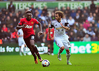 Jose Canas taking on the challenge from Manchester United's Danny Welbeck.<br />