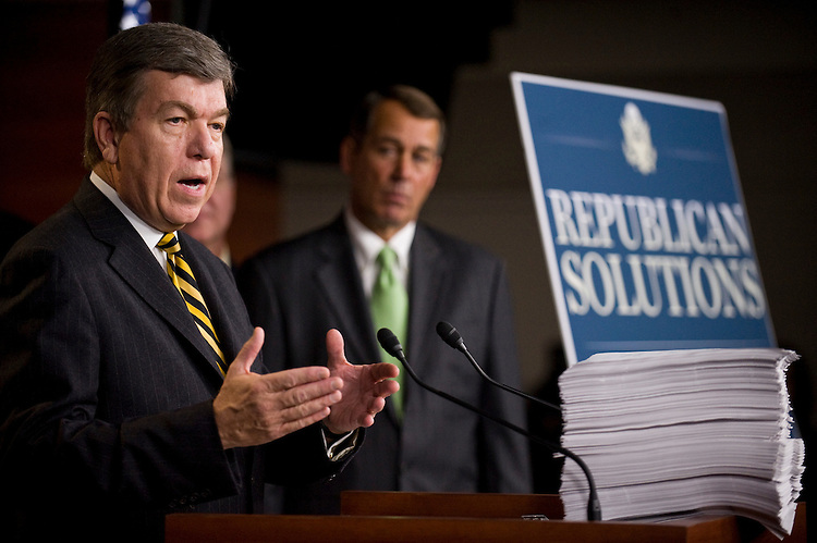 """WASHINGTON, DC - Oct. 29: Rep. Roy Blunt, R-Mo., House Minority Leader John A. Boehner, R-Ohio, during a news conference on the unveiling of the long-awaited House Democratic health care overhaul package, known as the """"Affordable Health Care for America Act."""" The nearly 2,000-page legislation (HR 3962) - on the podium in front of Blunt - is expected to be on the House floor late next week. Early indications were that Democrats across the ideological spectrum were lining up behind the main health care measure, which was assembled by Speaker Nancy Pelosi, D-Calif., and her team. Republicans, as expected, uniformly denounced the legislation. Not a single GOP member is expected to vote for it. (Photo by Scott J. Ferrell/Congressional Quarterly)"""