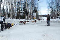 Chandler Wappett crosses at a road crossing on the inbound trail towards the finish line of the 2016 Junior Iditarod in Willow, Alaska, AK  February 28, 2016