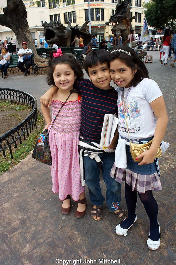 Three smiling Mexican children in Merida, Yucatan, Mexico...