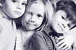 Black and white close up portrait of three children