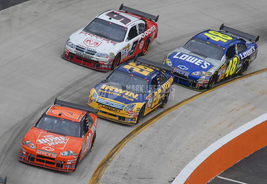 Apr 1, 2007; Martinsville, VA, USA; Nascar Nextel Cup Series driver Tony Stewart (20) leads Jamie McMurray (26) Kasey Kahne (9) and Jimmie Johnson (48) during the Goody's Cool Orange 500 at Martinsville Speedway. Martinsville marks the second race for the new car of tomorrow. Mandatory Credit: Mark J. Rebilas