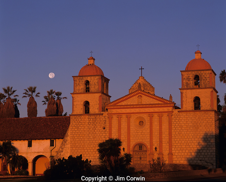 Santa Barbara Mission at sunrise with moonsetting with warm light on facade, Santa Barbara, California USA
