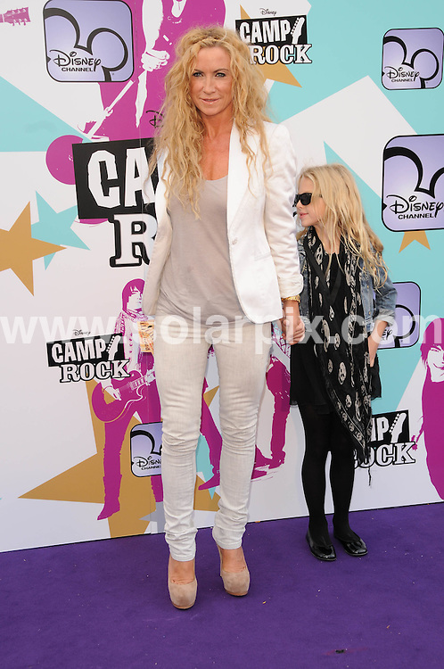 **ALL ROUND PICTURES FROM SOLARPIX.COM**.**WORLDWIDE SYNDICATION RIGHTS**.The Camp Rock premiere at the Royal festival hall in London..This pic: Meg Mathews and Daughter..JOB REF:7283-MSR    DATE:10_09_08 .**MUST CREDIT SOLARPIX.COM OR DOUBLE FEE WILL BE CHARGED* *UNDER NO CIRCUMSTANCES IS THIS IMAGE TO BE REPRODUCED FOR ANY ONLINE EDITION WITHOUT PRIOR PERMISSION*