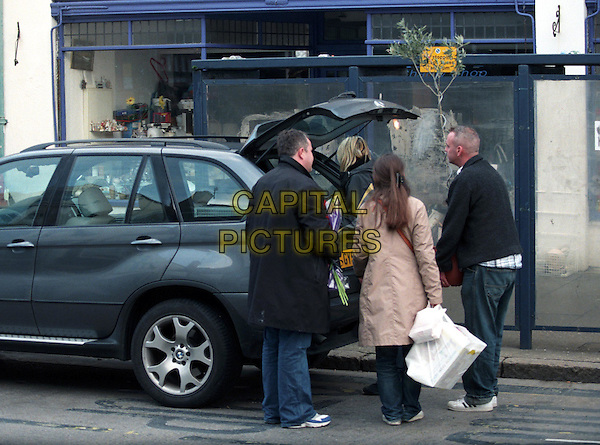 **EXCLUSIVE PICTURES**.NORMAN COOK (aka Fatboy Slim) & his lovely wife ZOE BALL .in Whitsatble High St, kent. They had left their BMW parked at the bus stop for quite some time. Norman had a bit of trouble getting his plant in the boot due to all Zoe's shopping, so placed it in the front and had to sit in the backseat for the drive home..sales@capitalpictures.com.www.capitalpictures.com.©Capital Pictures