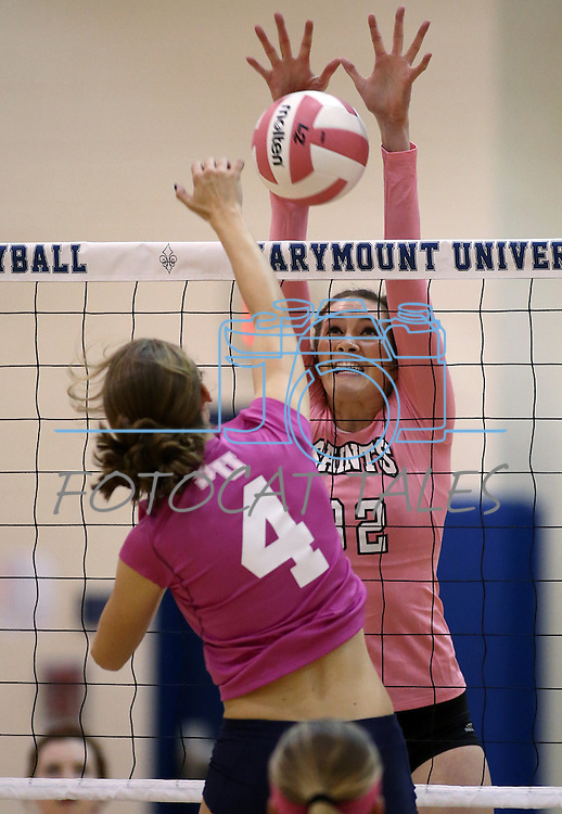 Marymount's Emily Shultis gets a block during a college volleyball match against Shenandoah at Marymount University in Arlington, Vir., on Tuesday, Oct. 8, 2013.<br />