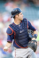 Minnesota Twins catcher Joe Mauer #7 warms up the pitcher between innings of the Major League Baseball game against the Texas Rangers at the Rangers Ballpark in Arlington, Texas on July 27, 2011. Minnesota defeated Texas 7-2.  (Andrew Woolley/Four Seam Images)
