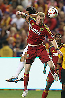 Nat Borchers #6 of Real Salt Lake heads the ball with Dwayne De Rosario (b) of D.C. United during the second half of the U.S. Open Cup Final on October  1, 2013 at Rio Tinto Stadium in Sandy, Utah. DC United beat Real Salt Lake 1-0 to win the championship.