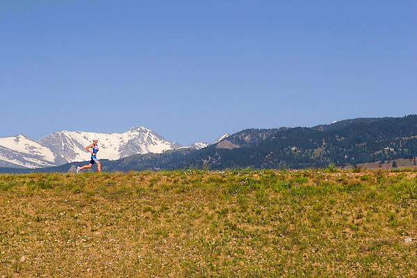 Man running in the Rocky Mountains, Boulder, Colorado John offers private photo tours of Boulder, Denver and Rocky Mountain National Park. .  John leads private photo tours in Boulder and throughout Colorado. Year-round.