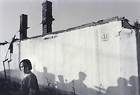 Albanian girl in a section Mitrovica of Mitrovica known as the Bosnian Place because many muslim slavs had lived there. The city was divided after the war by the Ibar river into a Serbian northern section and southern Albanian section. Albanians living in northern Mitrovica after the war lived in fear.