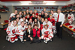 Wisconsin Badgers hockey team poses for a team photo in the locker room after  an NCAA tournament victory during a women's hockey game against the Minnesota Duluth Bulldogs at the Kohl Center in Madison, Wisconsin on March 12, 2011. Wisconsin won 2-1. (Photo by David Stluka)