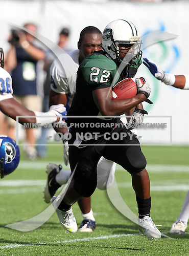Miami Central Rockets running back Joseph Yearby #22 runs upfield on a 7 yard touchdown run during the second quarter of the Florida High School Athletic Association 6A Championship Game at Florida's Citrus Bowl on December 17, 2011 in Orlando, Florida.  The score at halftime is Armwood 16 - Miami Central 14.  (Photo By Mike Janes Photography)