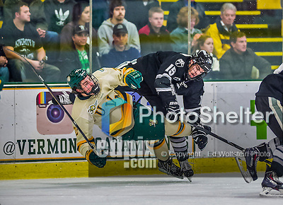 16 November 2013: University of Vermont Catamount Forward Brady Shaw, a Freshman from Ottawa, Ontario, is checked by Providence College Friar Forward Steven McParland, a Sophomore from Schreiber, Ontario, in the first period at Gutterson Fieldhouse in Burlington, Vermont. The Friars shut out the Catamounts to sweep the 2-game weekend Hockey East Series. Mandatory Credit: Ed Wolfstein Photo *** RAW (NEF) Image File Available ***