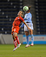 # 10 Carli Lloyd of the Chicago Red Stars goes up for  the ball against #6 Lori Lohman of the Washington Freedom. The Red Stars won the game 2-1