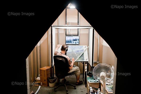 GDANSK, 30/05/2016:<br /> Polish painter Bartek Armusiewicz is painting in his box at the production venue of &quot;Loving Vincent,&quot; an animated film being made in Poland about Vincent Van Gogh that's using oil-painted cels. <br /> (Photo by Piotr Malecki / Napo Images)<br /> <br />  <br /> ####<br /> GDANSK, 30/05/2016:<br /> Produkcja filmu &quot;Twoj Vincent&quot; - pierwszego w historii filmu animowanego skladajacego sie w calosci z klatek osobno malowanych na plotnie przez dziesiatki zatrudnionych w tym celu malarzy z calego swiata.<br /> (Fot: Piotr Malecki dla NYT / Napo Images /  Napo Images) <br /> <br /> <br /> ### Zakaz publikacji w negatywnym kontekscie. Cena minimalna: 100 PLN ### Zakaz publikacji w Gazecie Polskiej ###