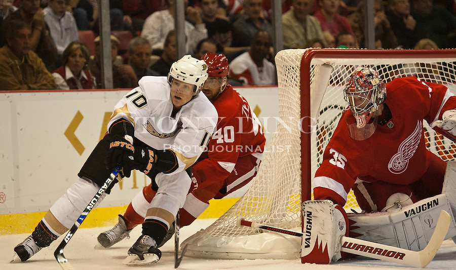 8 October 2010: Anaheim Ducks forward Corey Perry (10) skates around the goal defended by Detroit Red Wings forward Henrik Zetterberg (40) and goalie Jimmy Howard (35), in the first period of the Anaheim Ducks at Detroit Red Wings NHL hockey game, at Joe Louis Arena, in Detroit, MI...***** Editorial Use Only *****