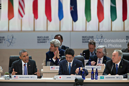 """United States President Barack Obama, left, speaks as Shinzo Abe, Japan's prime minister, center, and Nursultan Nazarbayev, Kazakhstan's president, listen during an opening plenary entitled """"National Actions to Enhance Nuclear Security"""" at the Nuclear Security Summit in Washington, D.C., U.S., on Friday, April 1, 2016. After a spate of terrorist attacks from Europe to Africa, Obama is rallying international support during the summit for an effort to keep Islamic State and similar groups from obtaining nuclear material and other weapons of mass destruction. <br /> Credit: Andrew Harrer / Pool via CNP"""