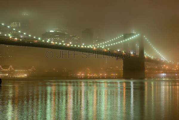 Brooklyn Bridge and East River in the Fog, Lower Manhattan in the background, New York City, New York State, USA
