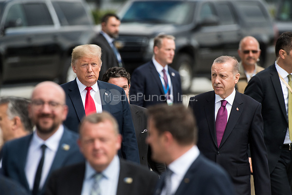 11 July 2018, Brussels, Belgium: Donald Trump, President of the United States of America, and Recep Tayyip Erdogan, President of Turkey, arrive at a photocall at the NATO Summit. From 11 July 2018 until 12 July 2018 government heads of the 29 NATO member states and European Union representatives, will participate in the Summit of the North Atlantic Treaty Organization. Photo: Bernd von Jutrczenka/dpa /MediaPunch ***FOR USA ONLY***