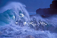 Storm waves crashing along coastline, Kauai