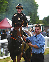 Winner of The Party Continues At The Chapel Nightclub Handicap, Lyrica's Lion is led into the winners enclosure rduring Ladies Evening Racing at Salisbury Racecourse on 15th July 2017