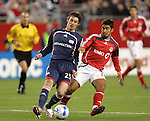 14 April 2007: New England's Andy Dorman (25) and Toronto's Paulo Nagamura (17) challenge for the ball. The New England Revolution defeated Toronto FC 4-0 at Gillette Stadium in Foxboro, Massachusetts in an MLS Regular Season game.