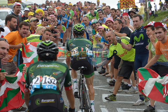 Huge crowds cheer Thomas Voeckler (FRA) and Yukiya Arashiro (JPN) Team Europcar on the slopes of Hautacam during Stage 18 of the 2014 Tour de France running 145.5km from Pau to Hautacam. 24th July 2014.<br /> Photo ASO/B.Bade/www.newsfile.ie