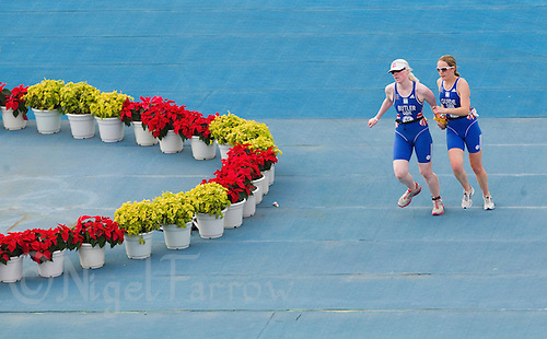 09 SEP 2011 - BEIJING, CHN - TRI-6 competitor Sara Butler (left) follows the directions of her guide Kat Berry as they turn on the run of the 2011 ITU World Paratriathlon Championships .(PHOTO (C) NIGEL FARROW)