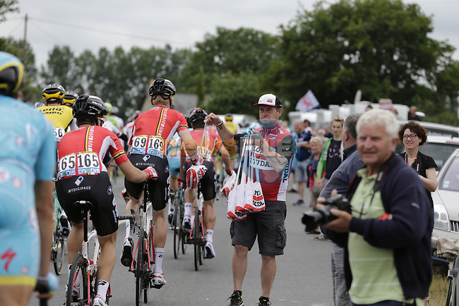 Lotto-Soudal soigneur hands his riders feed bags as they pass through the feed zone at La Hargriniere during Stage 3 of the 2016 Tour de France, running 223.5km from Granville to Angers, France . 4th July 2016.<br /> Picture: Eoin Clarke | Newsfile<br /> <br /> <br /> All photos usage must carry mandatory copyright credit (&copy; Newsfile | Eoin Clarke)