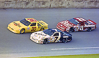 The cars of Alan Kulwicki (7), Michael Waltrip (30) and Geoff Bodine battle for position, Daytona 500, Daytona International Speedway, Daytona Beach, FL, February 17, 1991.  (Photo by Brian Cleary/www.bcpix.com)
