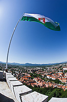 Slovenian flag flying from atop Ljubljana Castle, Ljubljana; Slovenia