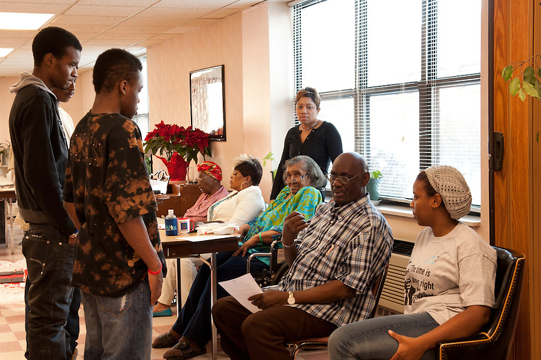 Chicago Public School student volunteering at Booth Manor Senior Center in Chicago during Chicago Cares Celebration of Service Martin Luther King day.