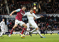 Barclays Premier League, West Ham United (red)V Swansea City Fc (white), Boelyn Ground, 02/02/13<br /> Pictured: Andy Carroll and Angel Rangel (right) come together<br /> Athena Picture Agency<br /> info@athena-pictures.com