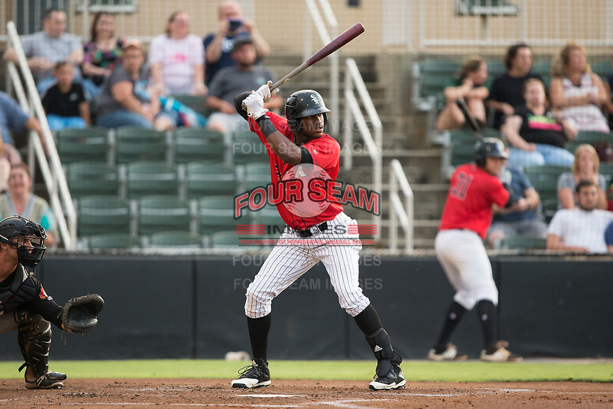 Micker Adolfo (27) of the Kannapolis Intimidators at bat against the West Virginia Power at Kannapolis Intimidators Stadium on June 17, 2017 in Kannapolis, North Carolina.  The Power defeated the Intimidators 6-1.  (Brian Westerholt/Four Seam Images)