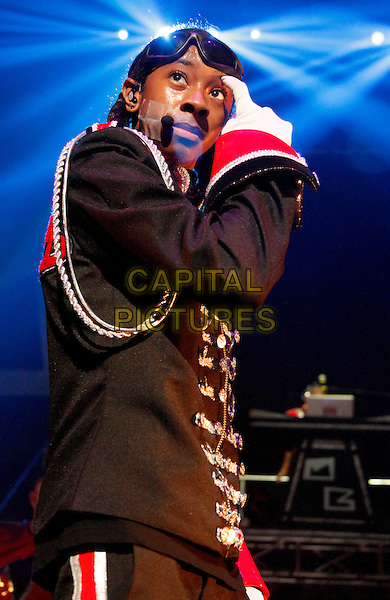 Ray Ray of Mindless Behavior.Teen hip-hop group Mindless Behavior headlined the the #1 Girl Tour at the Fox Theater in downtown Atlanta, GA, USA, .August 4th, 2012..music live on stage performing red black band group half length white gloves  suit military jacket side .CAP/ADM/DH.©Dan Harr/AdMedia/Capital Pictures.