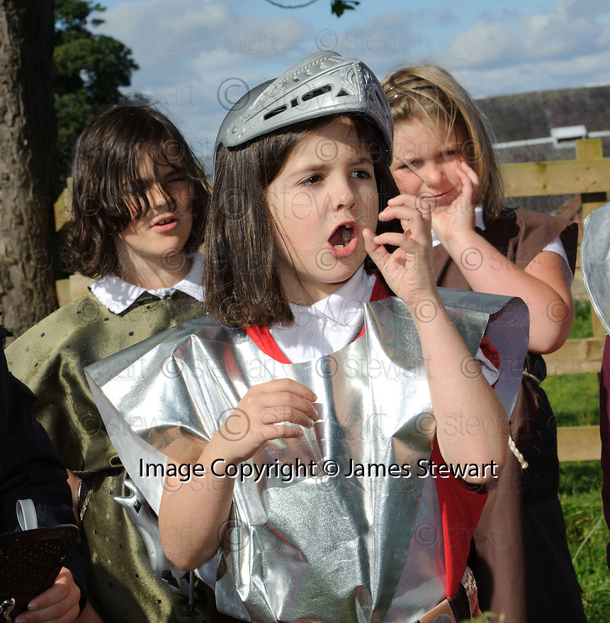 Pupils from Westquarter Primary School sing their Roman Song as they march from the school to the site of the Roman encampment at Mumrills Farm, Laurieston ....