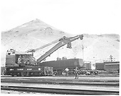 A D&amp;RGW standard gauge wrecker, #027, is helping a crew change out trucks on a standard gauge gondola at Salida.<br /> D&amp;RGW  Salida, CO