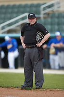 Home plate umpire Grant Akins works the NCAA game between the Mars Hill Lions and the Queens Royals at Intimidators Stadium on March 30, 2019 in Kannapolis, North Carolina. The Royals defeated the Bulldogs 11-6 in game one of a double-header. (Brian Westerholt/Four Seam Images)