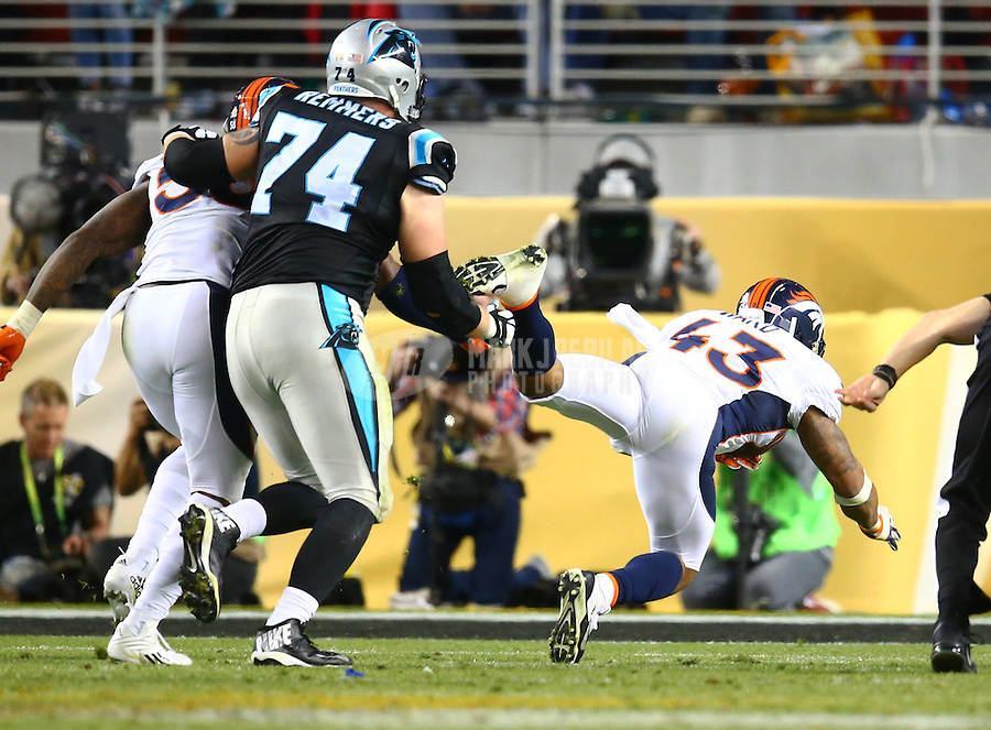 Feb 7, 2016; Santa Clara, CA, USA; Denver Broncos safety T.J. Ward (43) dives as he recovers a fourth quarter fumble against the Carolina Panthers in Super Bowl 50 at Levi's Stadium. Mandatory Credit: Mark J. Rebilas-USA TODAY Sports