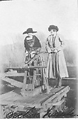 Two ladies on a hand-pump section car.<br /> Chama ?, NM