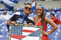 U.S. Fan with Salvador Fan.  The USMNT defeated El Salvador 5-1 at the quaterfinal game of the Concacaf Gold Cup, M&T Stadium, Sunday July 21 , 2013.
